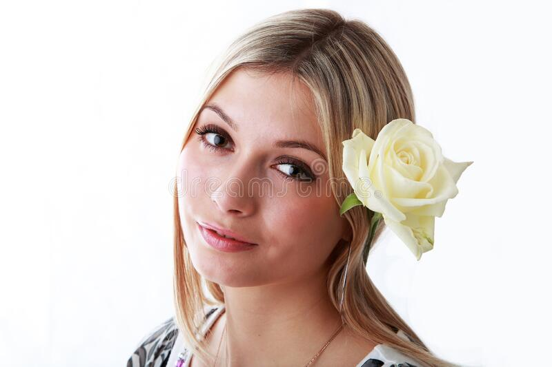 Beautiful girl with a flower on her head royalty free stock photos