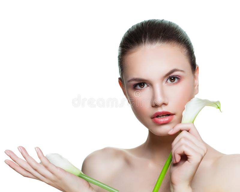 Beautiful girl with flower isolated on white background. Spa female model face with clear fresh skin royalty free stock image