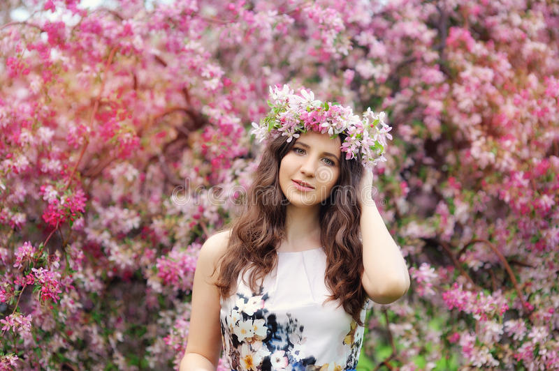 Beautiful girl with flowers in her hair. Spring.  stock photography