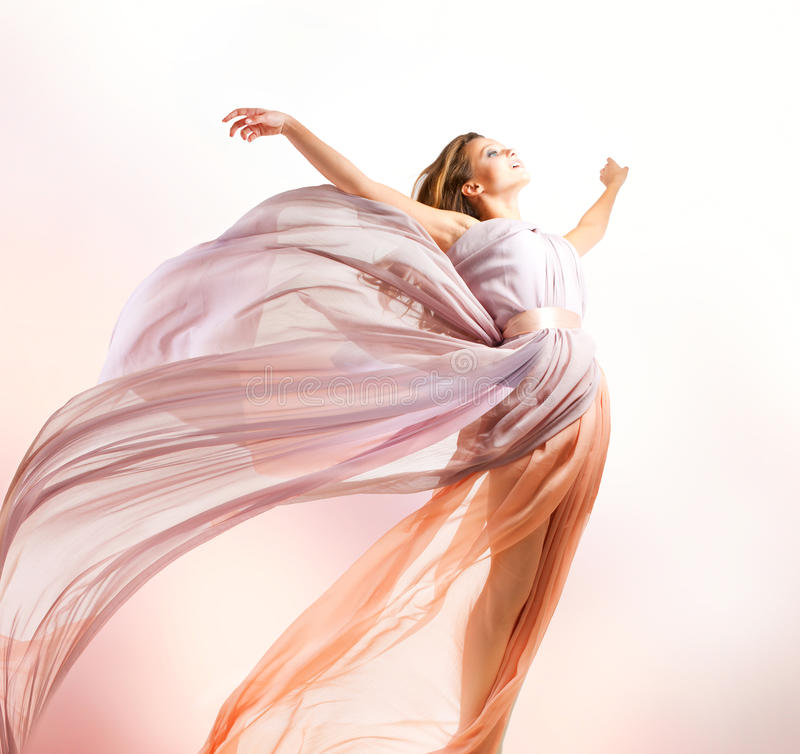 Beautiful Girl Flying. Beautiful Girl in blowing Dress Flying royalty free stock photography
