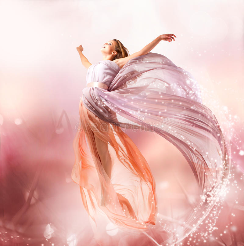 Beautiful Girl Flying. Fairy. Beautiful Girl in Blowing Dress Flying. Magic royalty free stock images