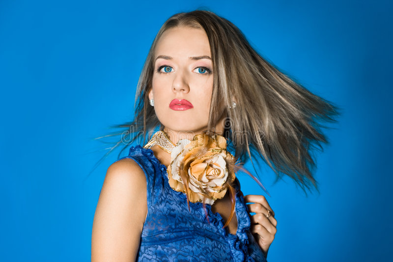 Beautiful girl with flying hairs royalty free stock image