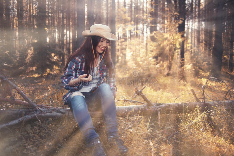 Beautiful girl in forest landscape with sun rays stock images
