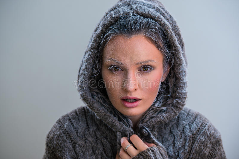 Beautiful girl with frost on face royalty free stock photo