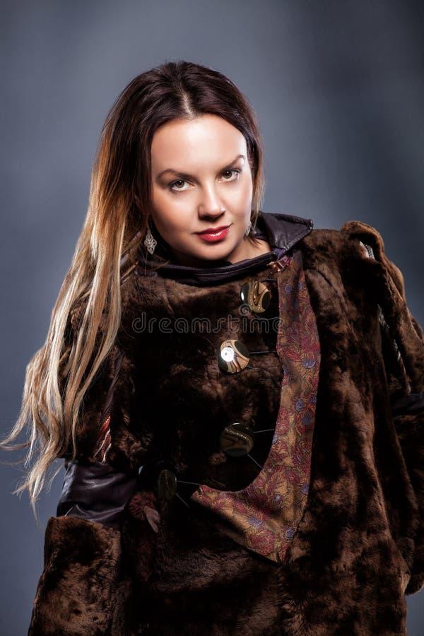 Beautiful girl in a fur coat stock photo