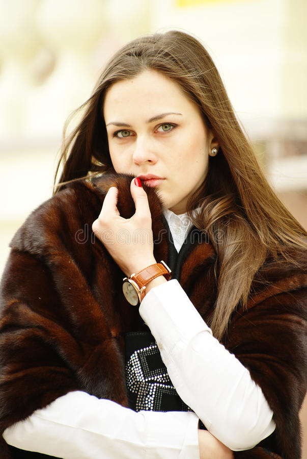 Beautiful girl in fur stole royalty free stock photography