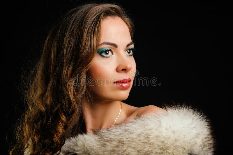 Beautiful girl and fur royalty free stock photography