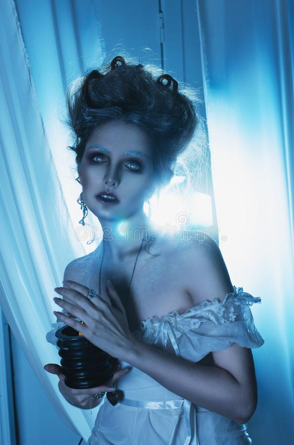 Beautiful girl ghost, witch, dead bride in a white dress with vi royalty free stock photo