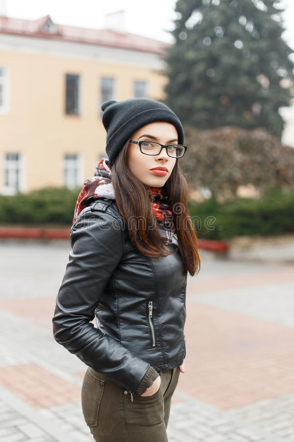Beautiful girl with glasses. Pretty woman in autumn day stock photos
