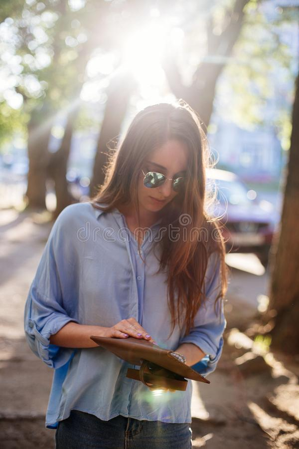 Girl is holding a clutch bag. royalty free stock photo