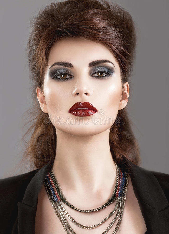 Beautiful Girl in the Gothic style with bright. Makeup. Beauty face. Picture taken in the studio stock photography