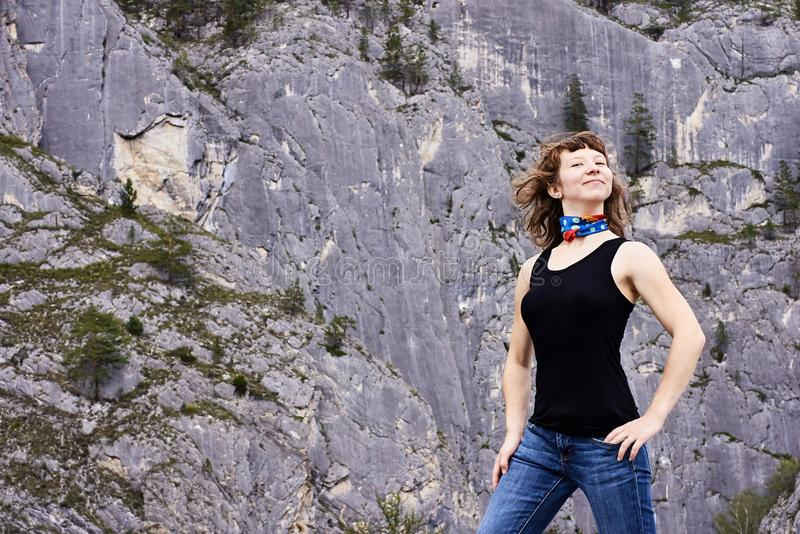 Beautiful girl. Gray rock. Green moss. Young tourist royalty free stock photos