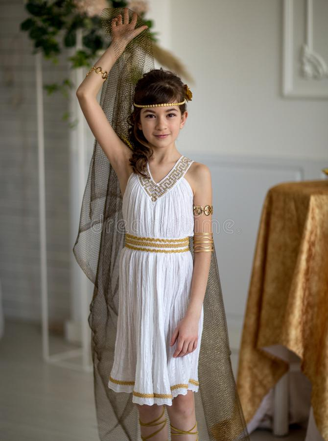 Beautiful girl in Greek dress royalty free stock images