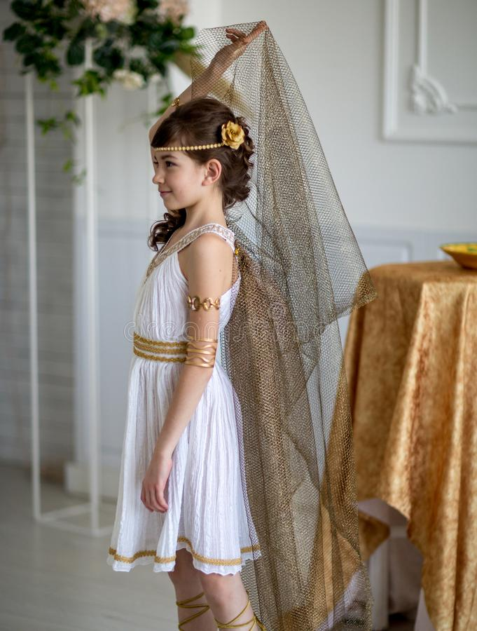 Beautiful girl in Greek dress stock image