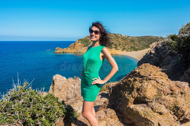 Girl is enjoying the sea and sunny day from view point on Vai bay, Crete, Greece stock photography