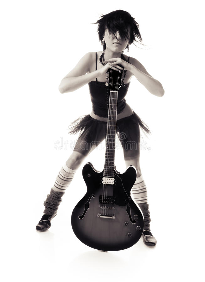 Beautiful girl with a guitar. On a black background royalty free stock image