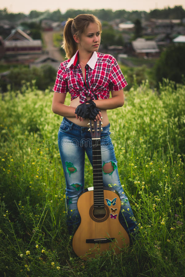 Beautiful girl with a guitar royalty free stock images