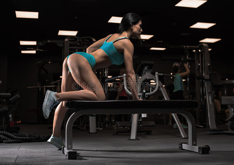 Beautiful girl at the gym stock photography