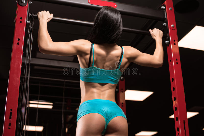 Beautiful girl at the gym stock image