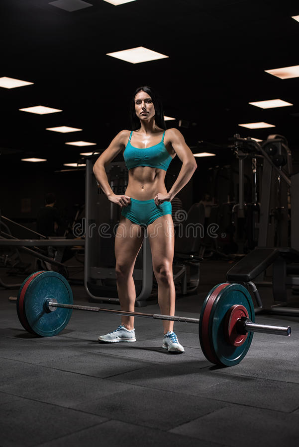 Beautiful girl at the gym royalty free stock photos