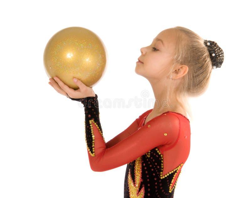 Beautiful girl gymnast with a ball. Beautiful girl gymnast doing exercise with a ball royalty free stock photography