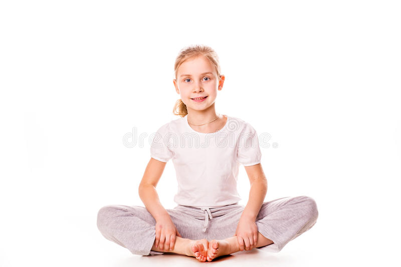 Beautiful girl gymnast exercising, stretching. On white royalty free stock images