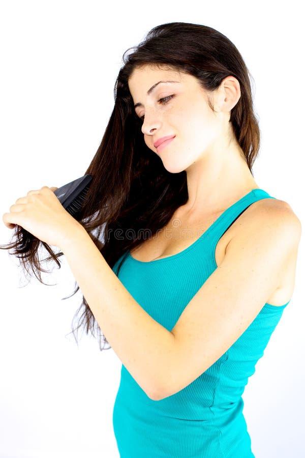 Beautiful girl happy brushing long hair royalty free stock photos