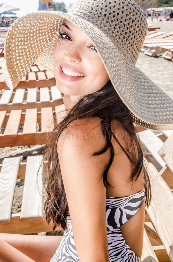 Beautiful girl with hat at the beach stock photography
