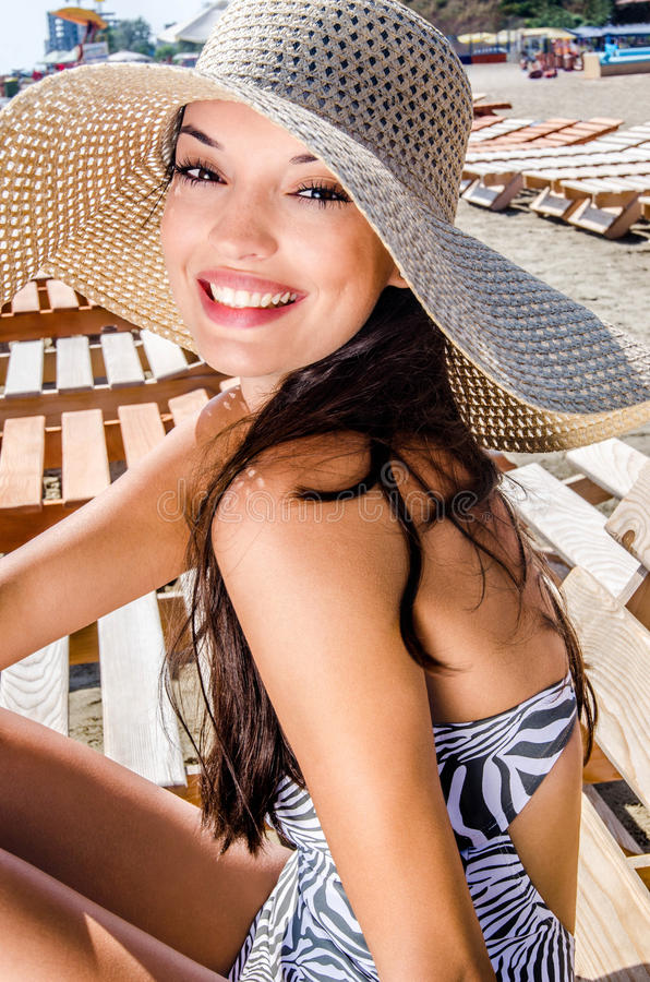 Beautiful girl with hat at the beach royalty free stock photography