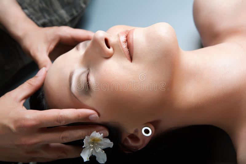 Beautiful girl having massage in spa
