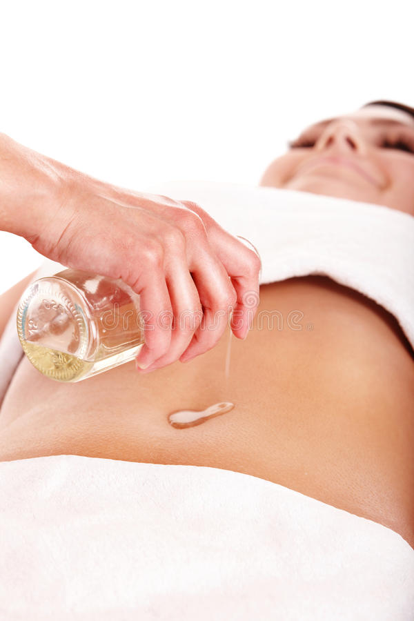 Beautiful girl having stomach massage. royalty free stock photography