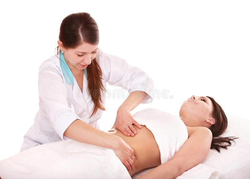 Beautiful girl having stomach massage. stock images