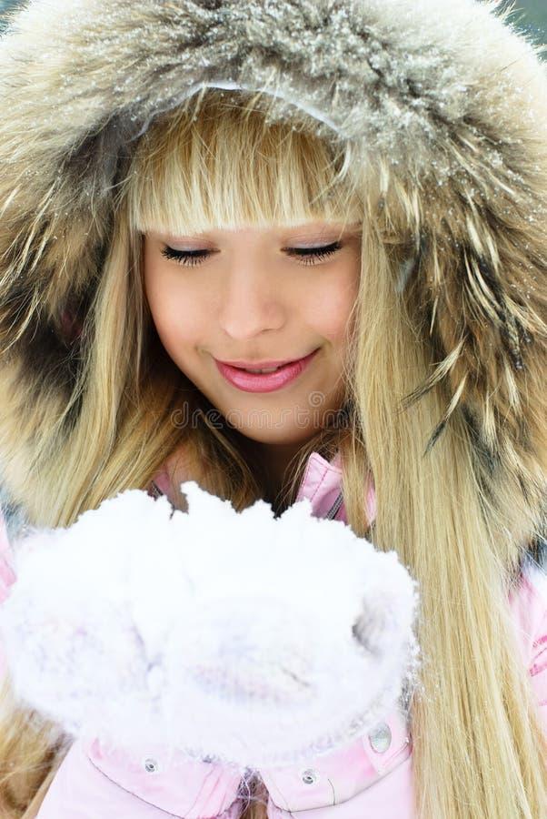 Beautiful girl having a walk in winter park