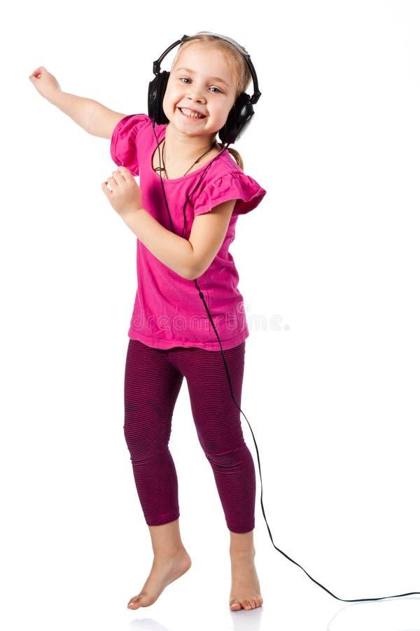beautiful girl in headphones dancing to the music stock