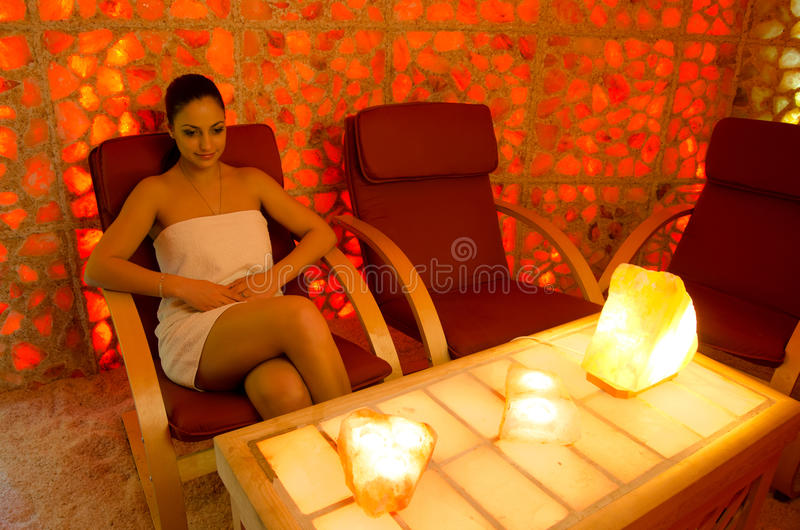 Beautiful girl healing in the salt room. royalty free stock photography