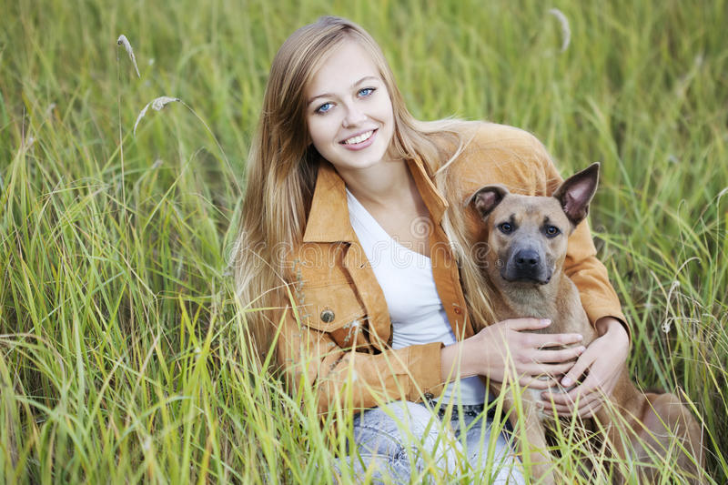 Download Beautiful girl and her dog stock photo. Image of adult - 16137222