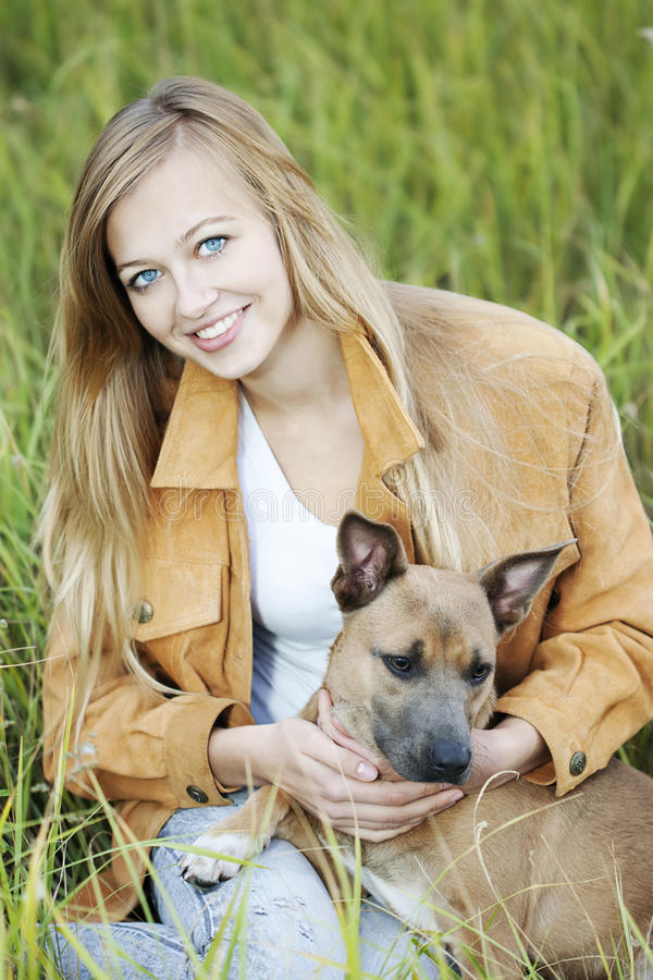 Download Beautiful girl and her dog stock image. Image of brown - 16137295