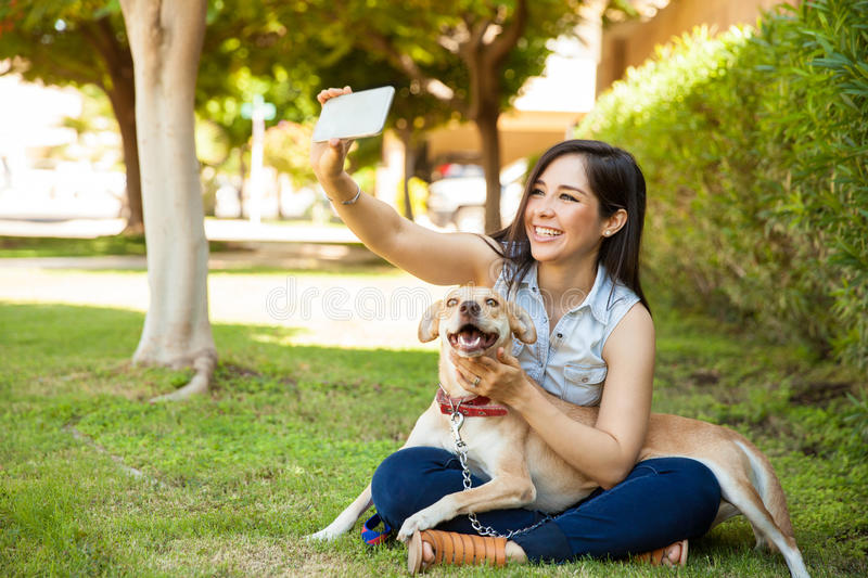 Beautiful girl and her dog taking a selfie royalty free stock photos