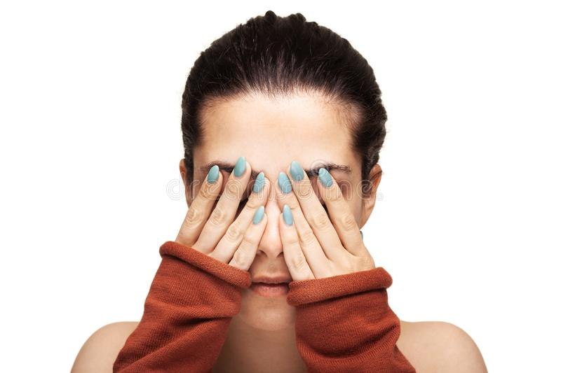 Beautiful girl hiding her face stock image