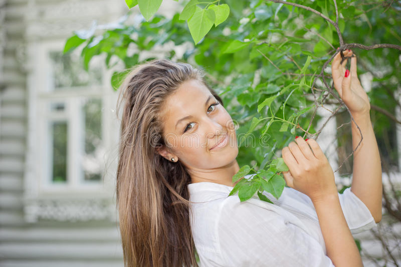 Download Beautiful Girl Hold For Branch With Leaves Stock Photo - Image of blossom, farming: 27198714