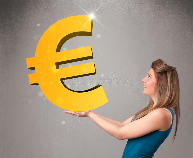 Download Beautiful Girl Holding A Big 3d Gold Euro Sign Stock Photo - Image: 32069926