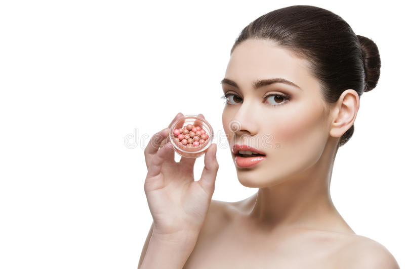 Beautiful girl holding blush container royalty free stock images
