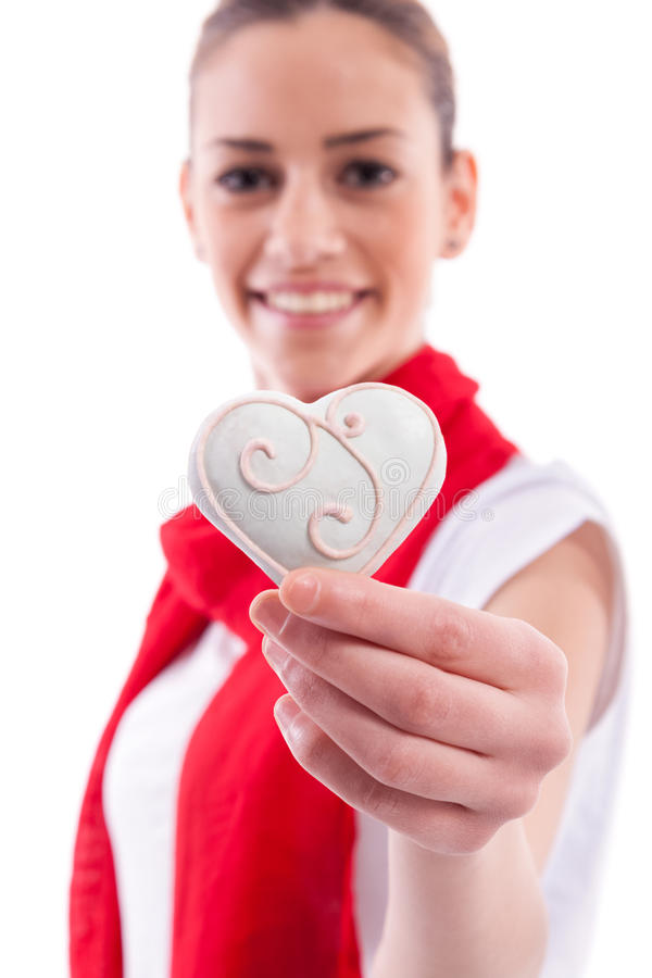 Beautiful girl holding candy heart royalty free stock photo