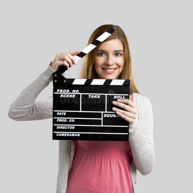 Beautiful girl holding clapboard royalty free stock photo