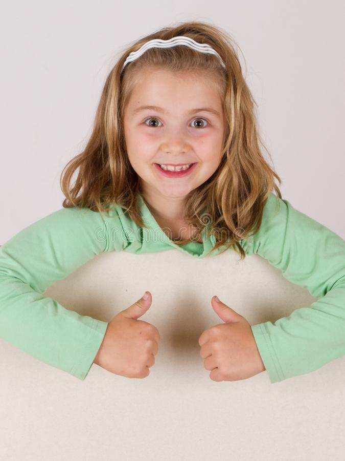 Beautiful girl holding empty board stock photography