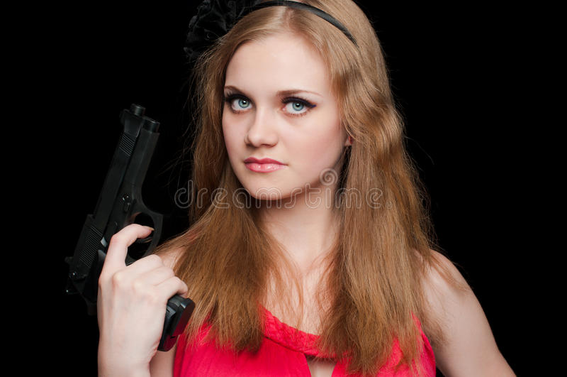 Beautiful girl holding a gun royalty free stock photo