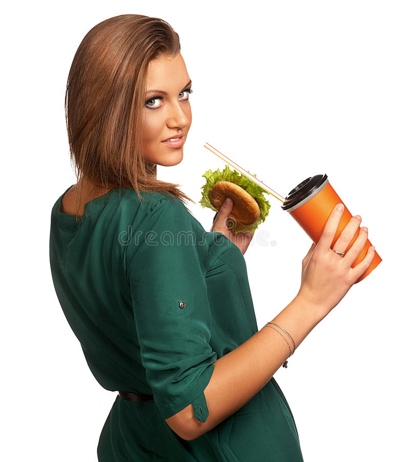 Beautiful girl holding hamburger and cola. Beautiful woman holding hamburger and cola isolated on white royalty free stock photography