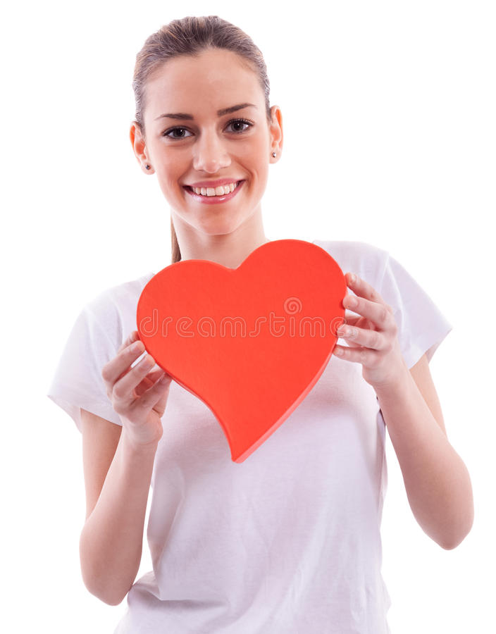 beautiful girl holding heart stock images