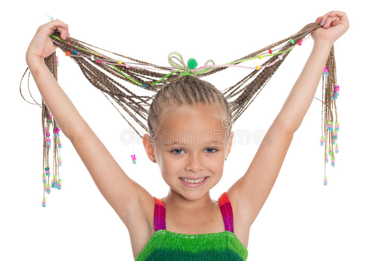 Beautiful girl holding her dreadlocks royalty free stock photos