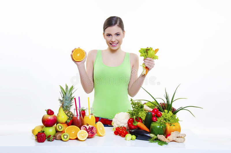 Beautiful girl holding orange and lettuce royalty free stock photography